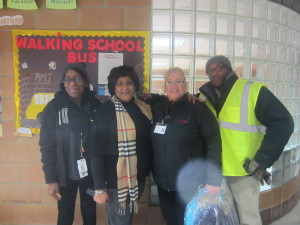 Rebecca Johnson Parent Facilitator, Principal Darcia Milner, and SHA's Rental Assistance Director Blanca Berrios and Family Self-Sufficiency Coordinator Joseph Dumpson. SHA found donations of coats, hats and mittens for children walking to and from the school.
