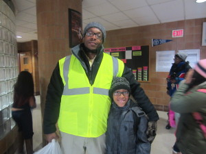 SHA Family Self-Sufficiency Coordinator Joseph Dumpson with walker Gregory Bodison, who is 8.
