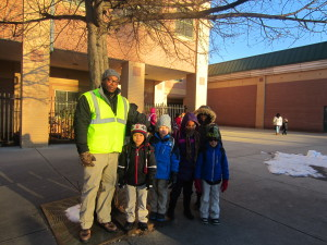 SHA's Joe Dumpson and some of his charges on the Walking School Bus at Rebecca Johnson School.
