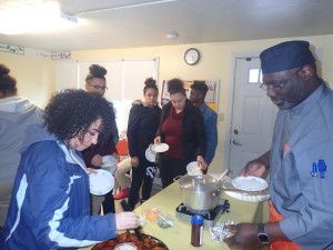 Chef Kelly Dobbins, owner of Iona's Catering in the Indian Orchard section of the city, serves up chili and wings at the Robinson Gardens Youth Group.