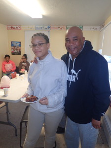 Thirteen-year-old Shamya Cotto-Gates and SHA Youth Coordinator Jimmie Mitchell share a smile.