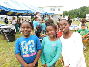 Sisters Brianne, Caitlyn and Alexis Gasque, ages 8, 7 and 10, show off their painted faces at Robinson Gardens.
